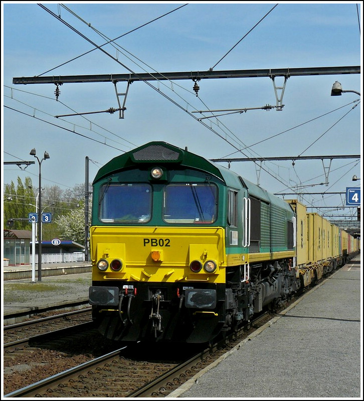 The Ascendos Rail Leasing Sarl Class 66 PB02 is hauling a freight train through the station Antwerpen-Noorderdokken on April 24th, 2010.