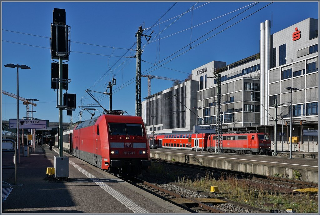 The DB 101 008-9  with a IC to Zürich and a E 111 in Stuttgart Main Station.