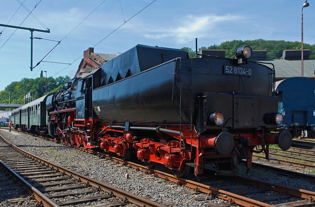 The German Steam Locomotive 52 8134-0 from the Eisenbahnfreunde Betzdorf (Railway friends Betzdorf) on 18.08.2012 in the South Westphalian Railway Museum in Siegen (Germany), the locomotive has appended her train.