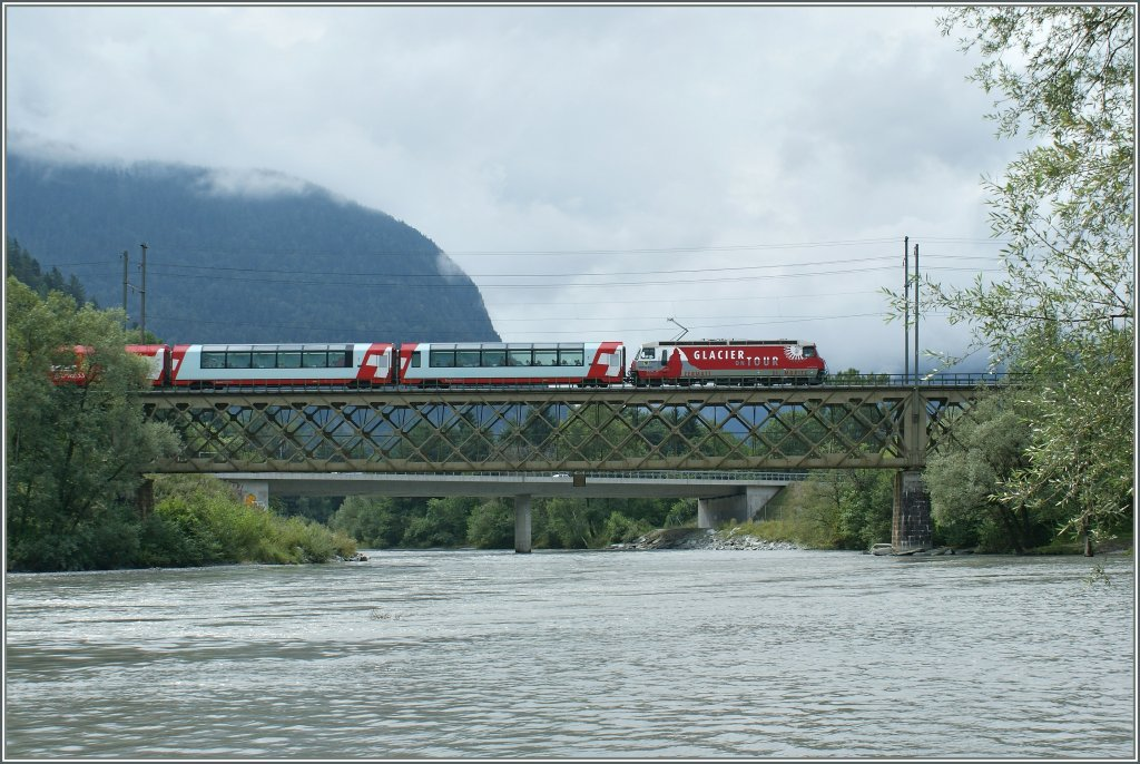 The  Glacier Express  coming from St Moritz on the way to Zermatt by Reichenau.