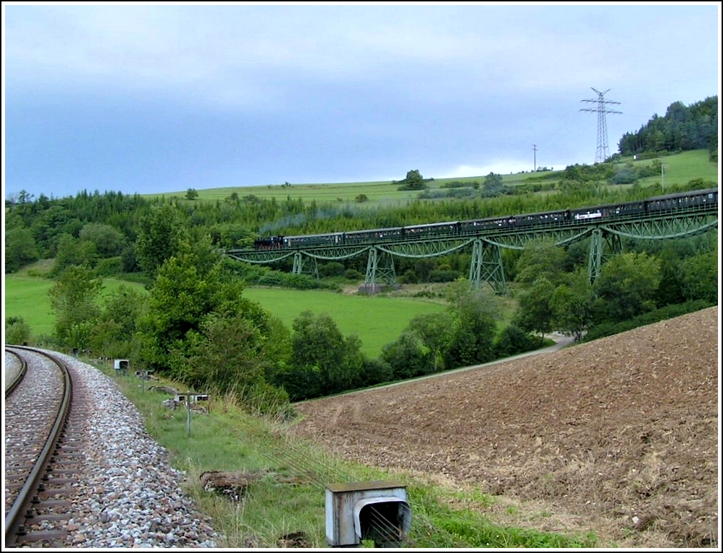 The heritage train of the Wutachtalbahn, popularly known as the Sauschwänzlebahn (pigtail line), is running on the Biesenbach viaduct near Epfenhofen on August 19th, 2006.
