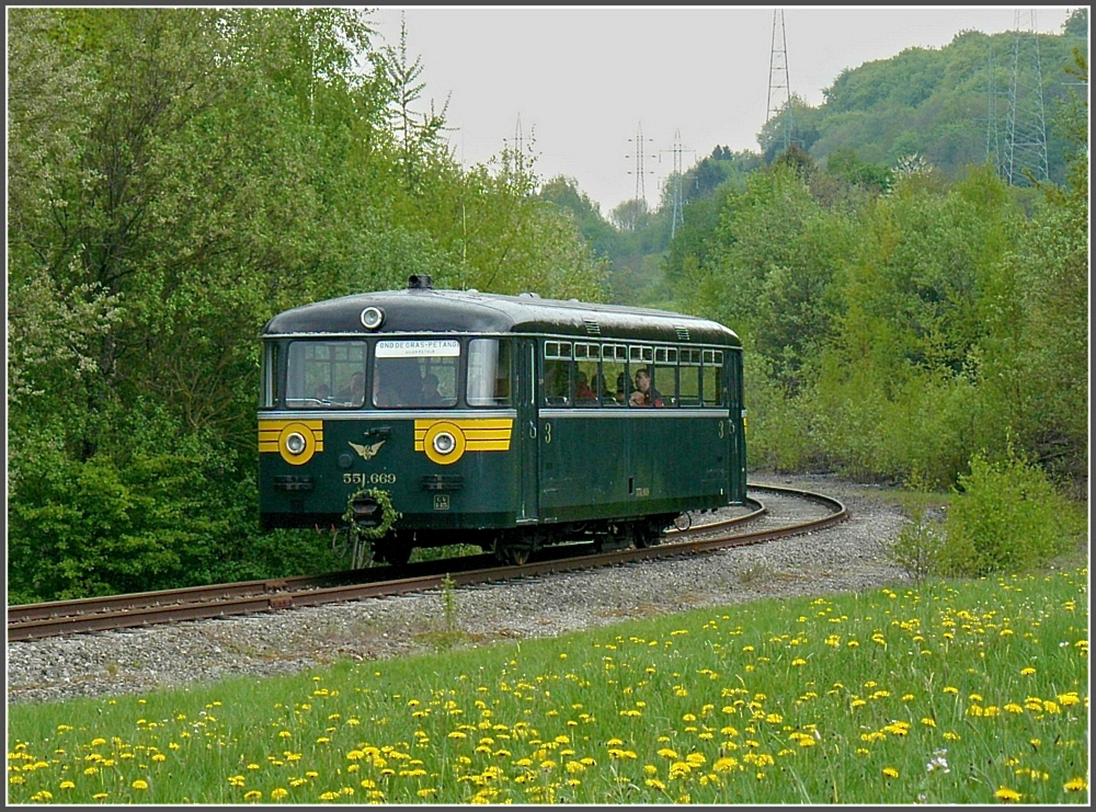 The historical Uerdinger railcar 551.669 is running on the track of the heritage railway  Train 1900  between Pétange and Fond de Gras on May 1st, 2010.