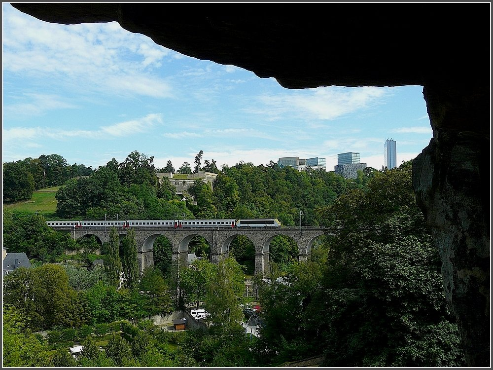 The IR Liers-Luxembourg City is crossing the Clausen bridge on August 1st, 2009. The picture was taken out of the so called casemates of the Bock, a extraorinary network of 23 km underground tunnls, which were formerly used as underground defence galleries.