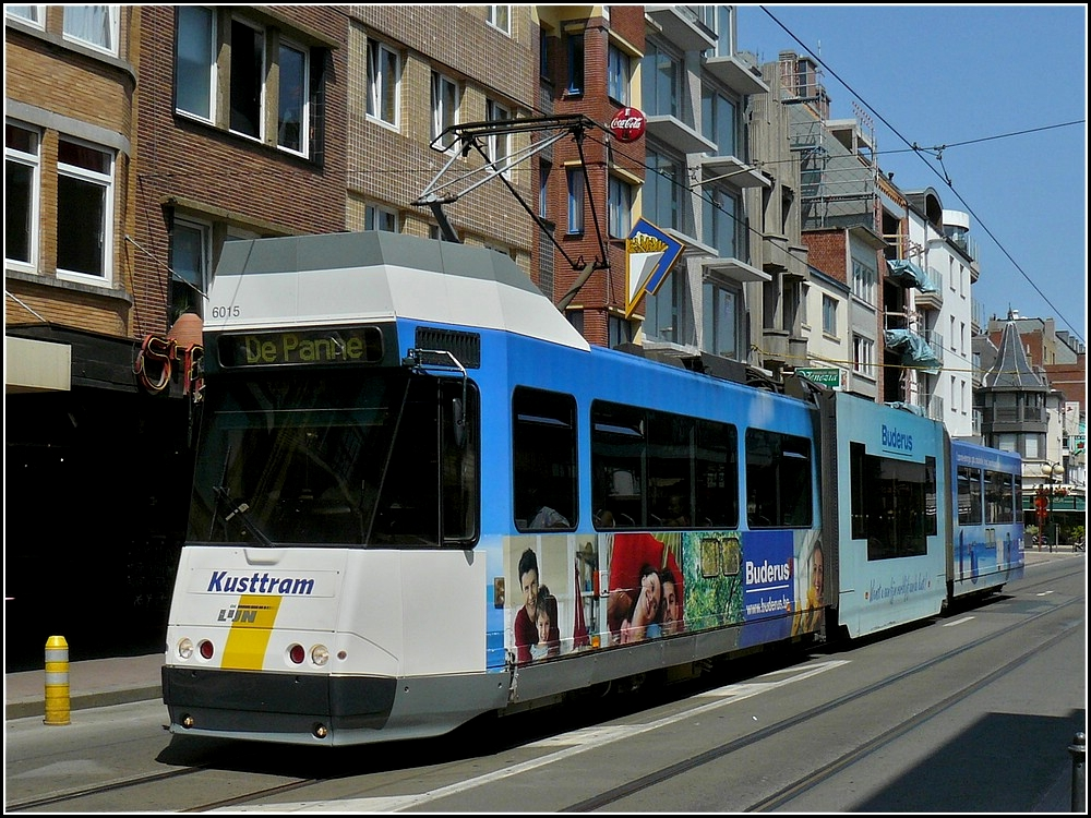 The Kusttram N° 6015 is running through De Panne on July 10th, 2010.