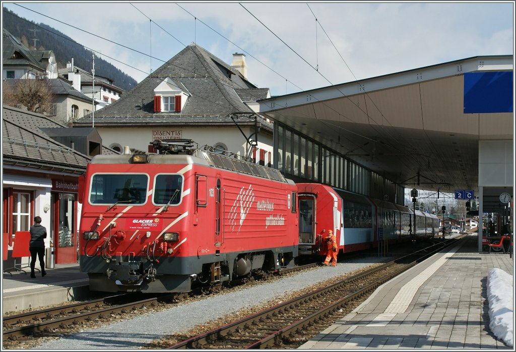 The MGB HGe 4/4 103 takes the Glacier Express in Disentis. 