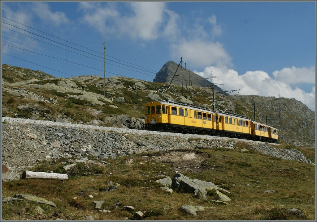 The Old timer RhB ABe 4/4 N° 30 and 34 wit two  B  near Bernina Ospizio,.