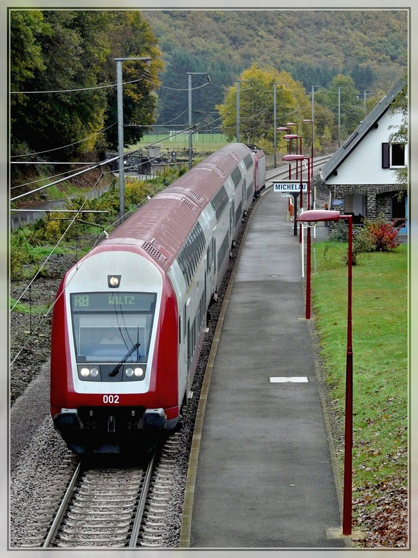 The RB 3209 Luxembourg City - Wiltz is leaving the station of Michelau on October 25th, 2009.