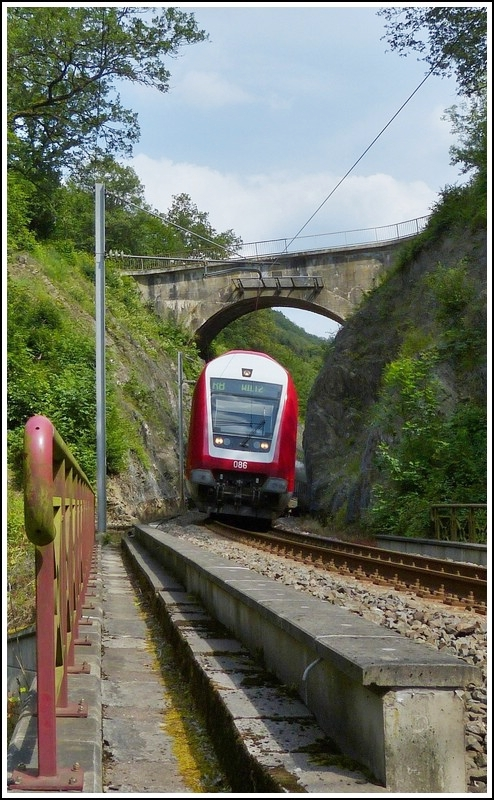 The RB 3214 Luxembourg City - Wiltz is running near Merkholtz on July 4th, 2012.