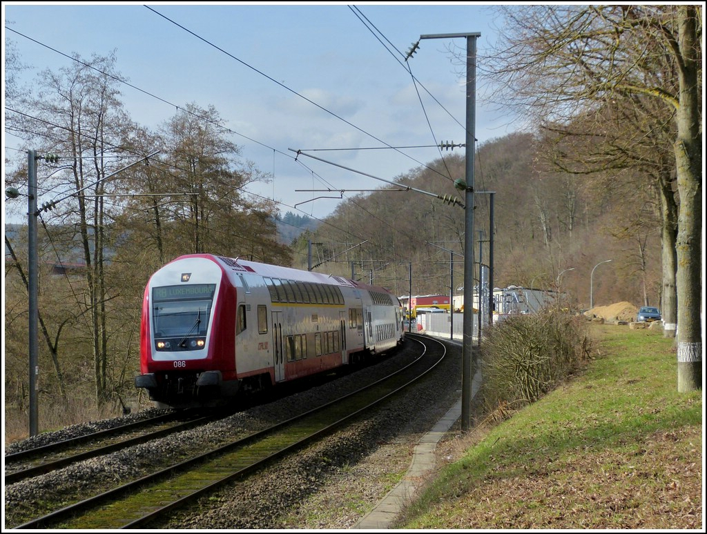 The RB 3595 Diekirch - Luxembourg City is running between Colmar-Berg and Cruchten on March 9th, 2012.