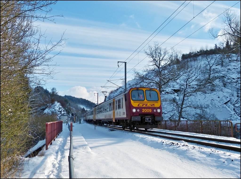 The RE 3761 Luxembourg City - Troisvierges pictured between Maulusmühle and Cinqfontaines on February 9th, 2013.