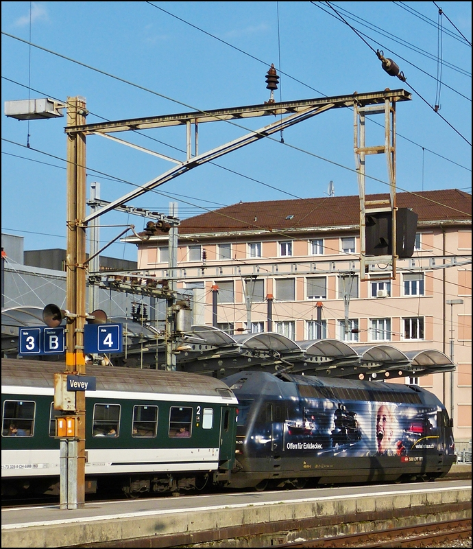 The Re 460 019-3 is leaving the station of Vevey on May 26th, 2012.