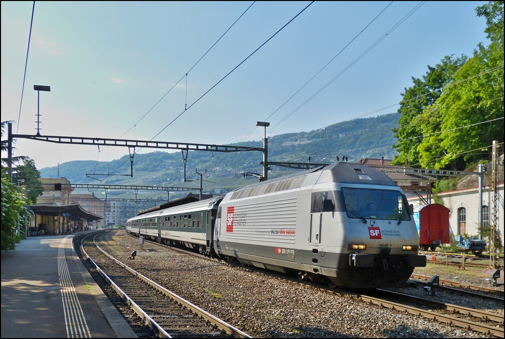 The Re 460 107-6 is hauling a IC Geneva Airport - Brig out of the station of Vevey on May 26th, 2012.