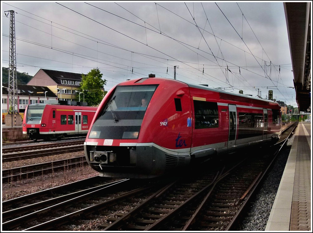 The red SNCF whalefish is leaving the main station of Trier on August 28th, 2011.