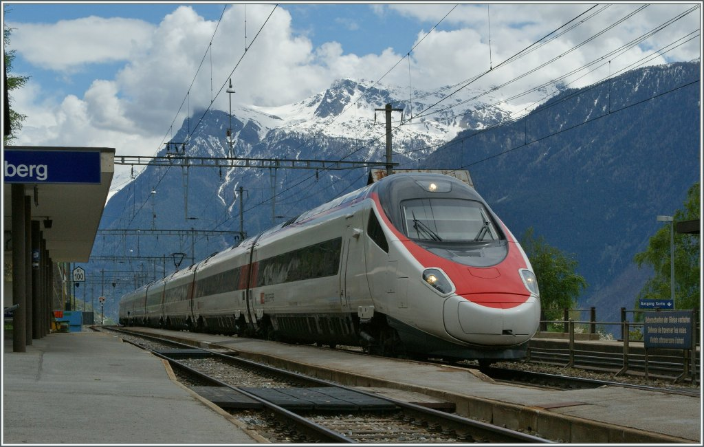 The SBB ETR 610 from Milan to Bern is running over the BLS Mountain Line. Ausserberg, 05.05.2013