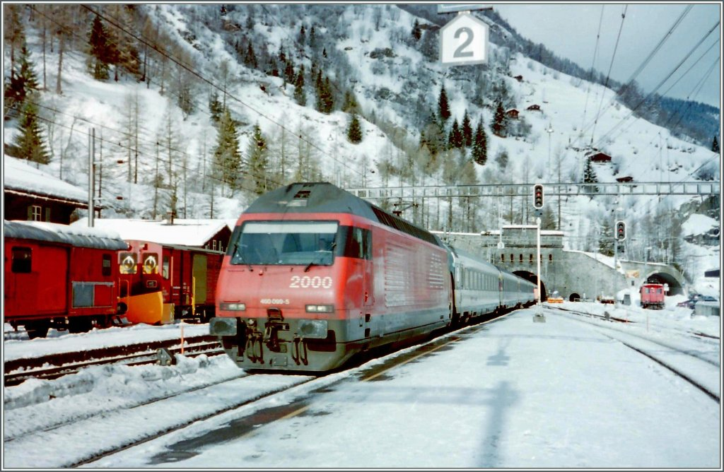 The SBB Re 460 099-5 is coming out of the Lötschbergtunnel in Goppenstein.