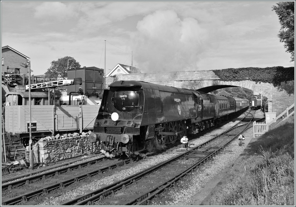 The  Swanage Railway  34070 is leaving Swanage. 