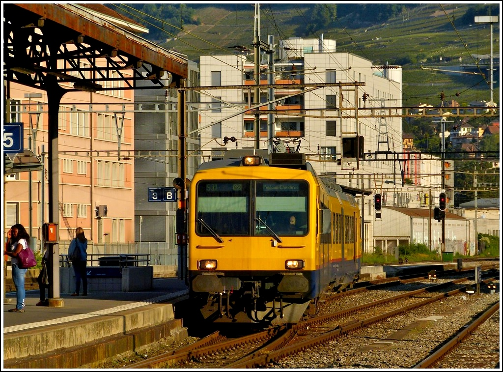 The  Train des Vignes  is entering into the station of Vevey in the early morning of May 29th, 2012.
