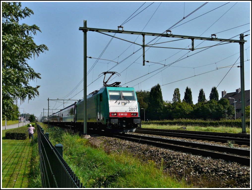 The TRAXX 2801 is hauling the IC Amsterdam-Antwerpen through Oudembosch on September 3rd, 2011.