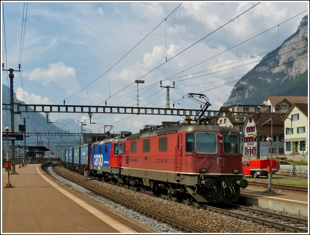 Two Re 4/4 II are hauling a goods train through the station of Erstfeld on May 24th, 2012.