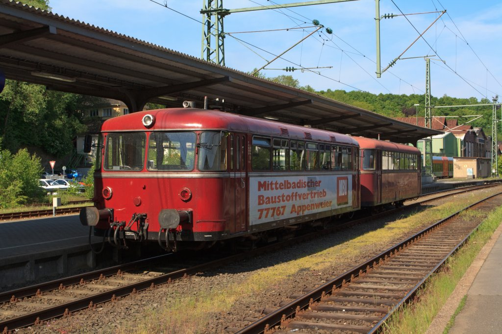 Uerdinger railcar 798 818-1 (Pfalzbahn) with Sidecar 998 880-9 is in the Station Betzdorf/Sieg on 05/08/2011.