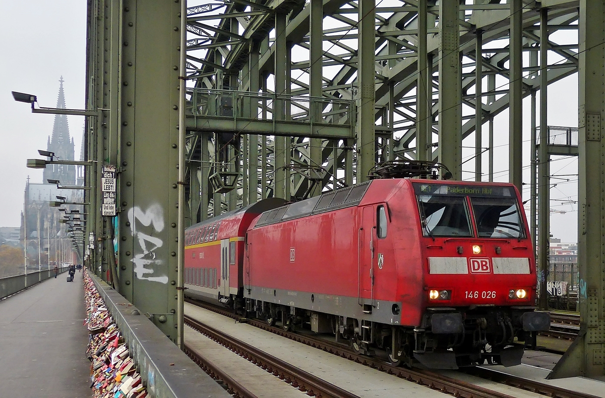 . 146 026 is hauling the Re 1 to Paderborn main station over the Hohenzollernbrücke in Cologne on November 20th, 2014.
