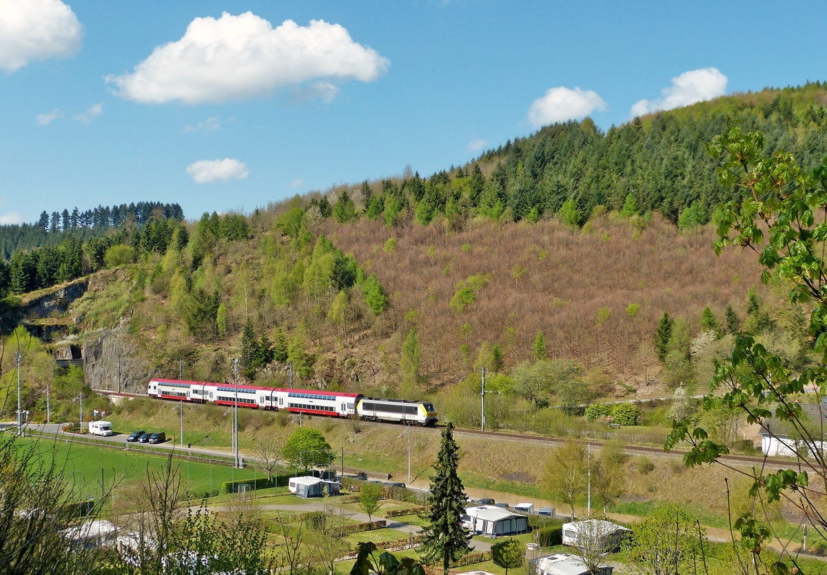 . 3003 is arriving with the IR 3710 Luxembourg City - Troisvierges in Clervaux on April 21st, 2014.