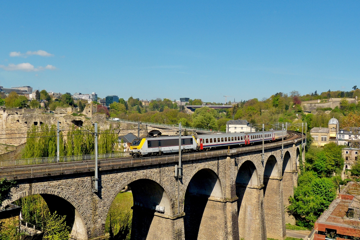 . 3008 is hauling the IR 113 Liers - Luxembourg City over the Clausen viaduct in Luxembourg City on April 16th, 2014.