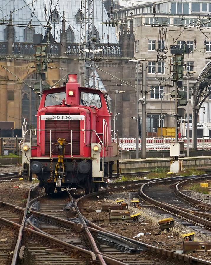 . 363 113-2 is running alone through the main station of Cologne on November 20th, 2014.