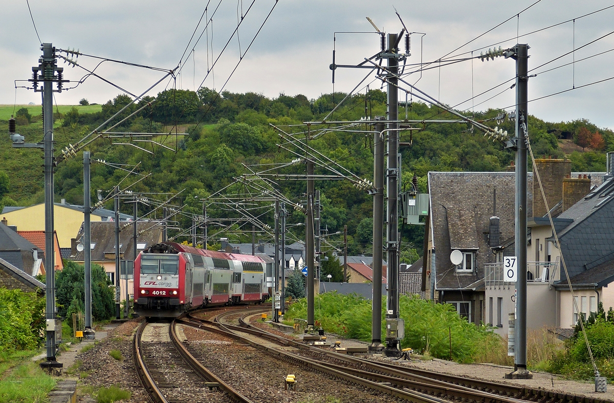 . 4012 is hauling a local train from Trier into the station of Wasserbillig on August 30th, 2014.