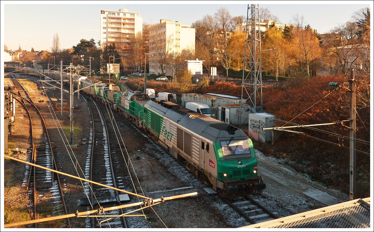 . A freight train is running through the station of Mulhouse on December 10th, 2013.