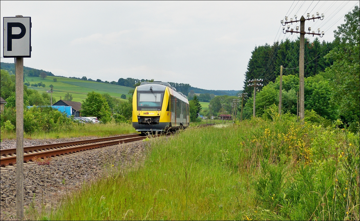 . A HLB LINT 41 is leaving the station Unnau-Korb on May 26th, 2014.