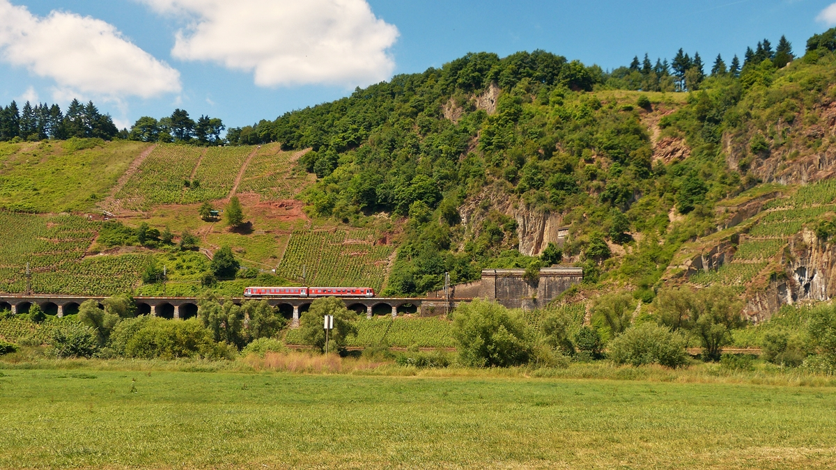 . A local train from Traben-Trarbach is running on the slope viaduct near Pünderich on June 21st, 2014.