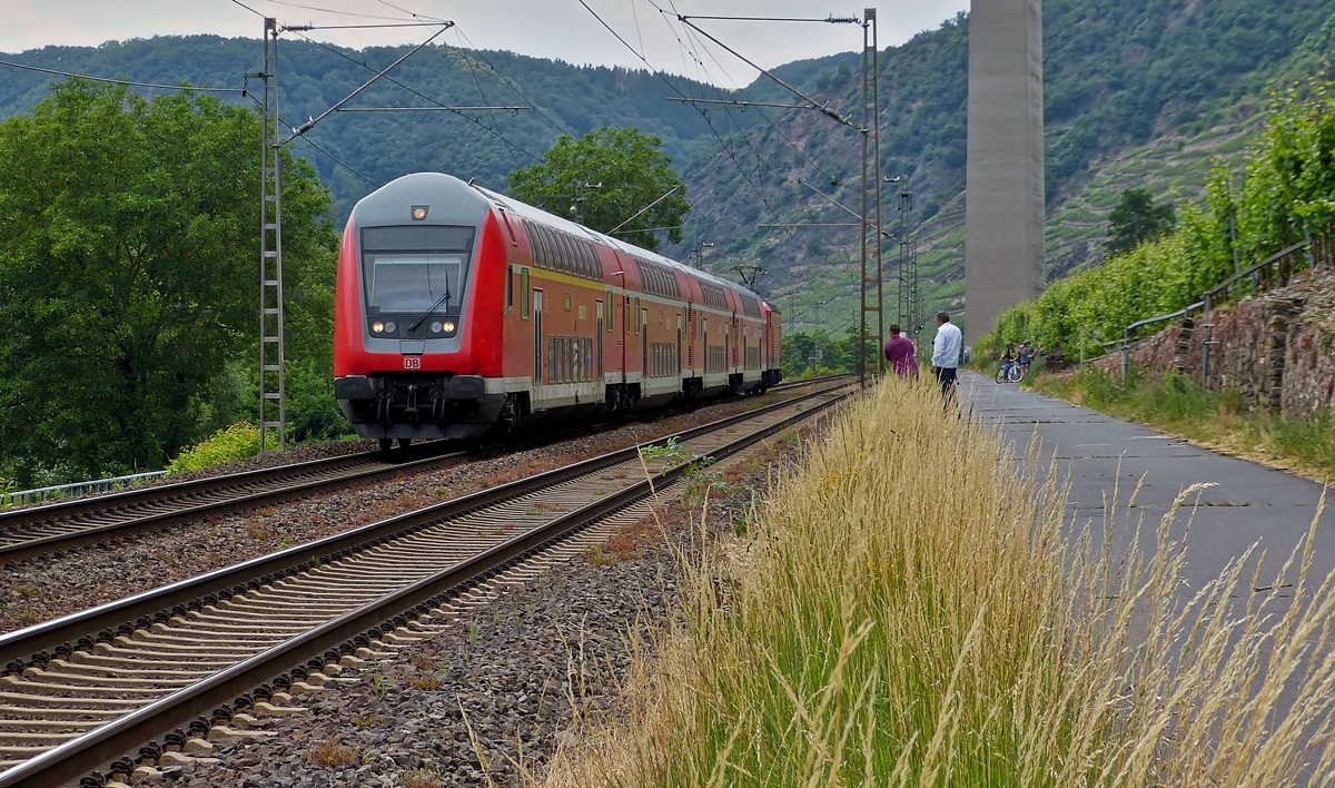 . A local train to Koblenz is running through Winningen on June 20th, 2014.