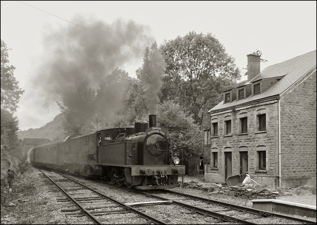 . A steam train is arriving in the station Dorinne-Durnal on the heritage railway track Le Chemin de Fer du Bocq on August 17th, 2013.