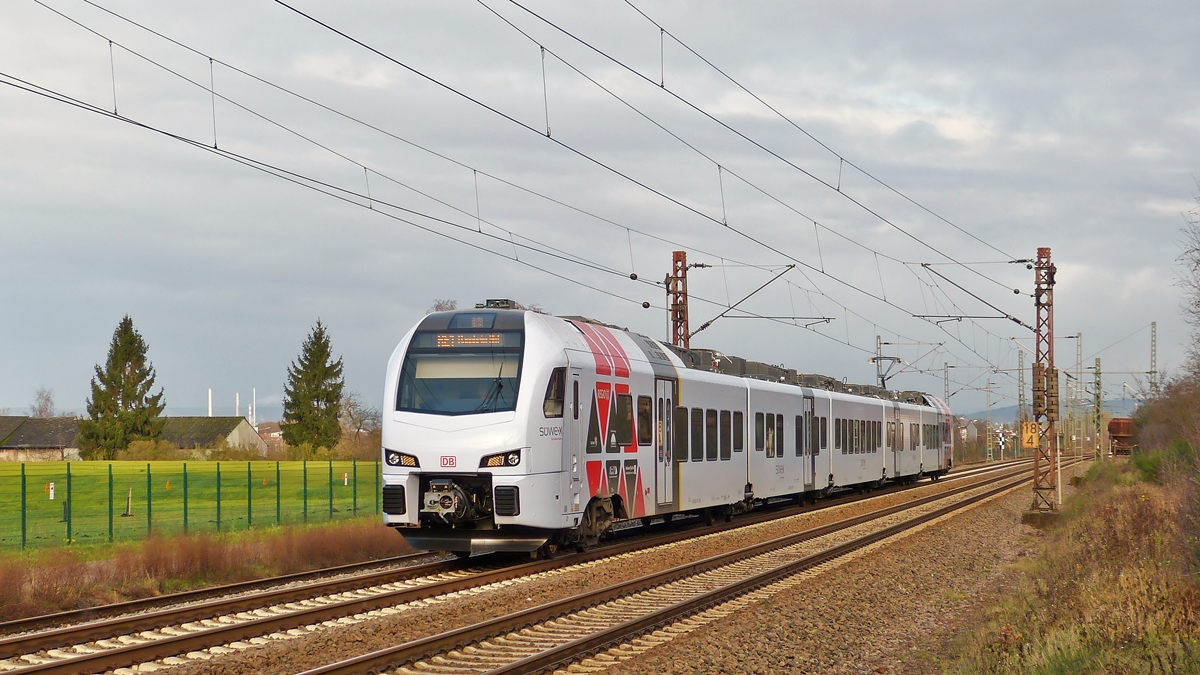 . A SÜWEX Stadler FLIRT is running through Ensdorf on December 20th, 2014.