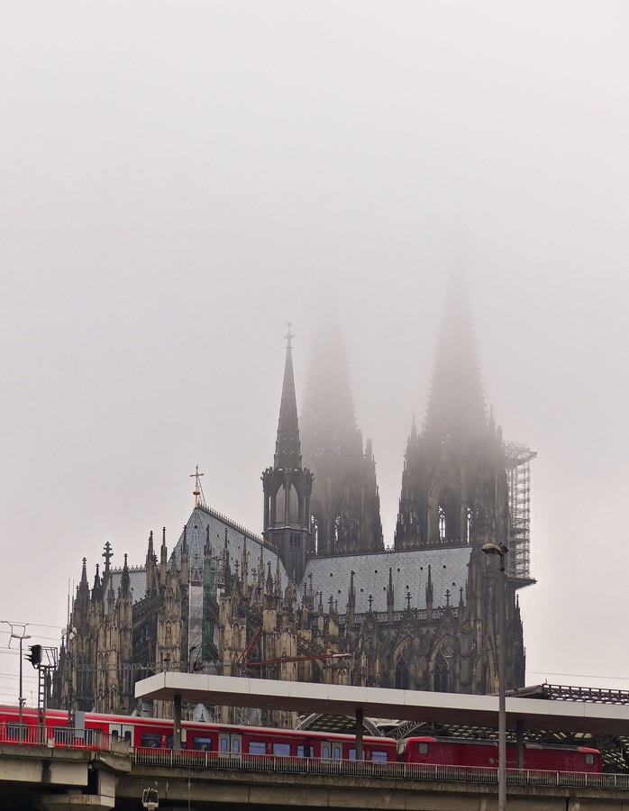 . A train of the Kölner S-Bahn is arriving in Cologne main station on the foggy November 20th, 2014.
