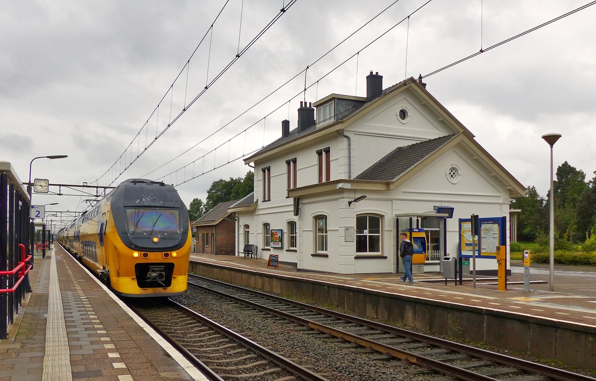 . A VIRM Regiorunner is running without stop through the station of Oudenbosch on September 4th, 2015.