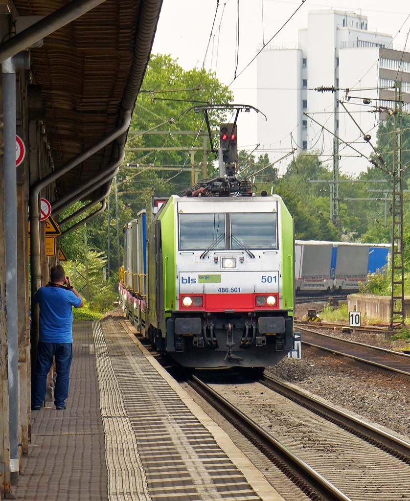 . BLS Re 486 501 is hauling a freight train through the station of Bonn-Beuel on June 27th, 2015.