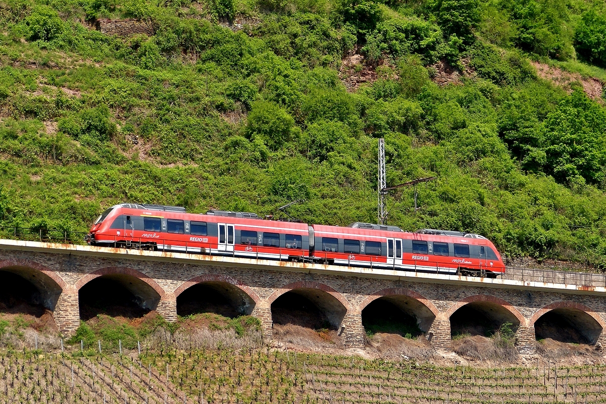 . DB Regio 442 003  Nittel  photographed on the slope viaduct near Pünderich on May 13th, 2015.