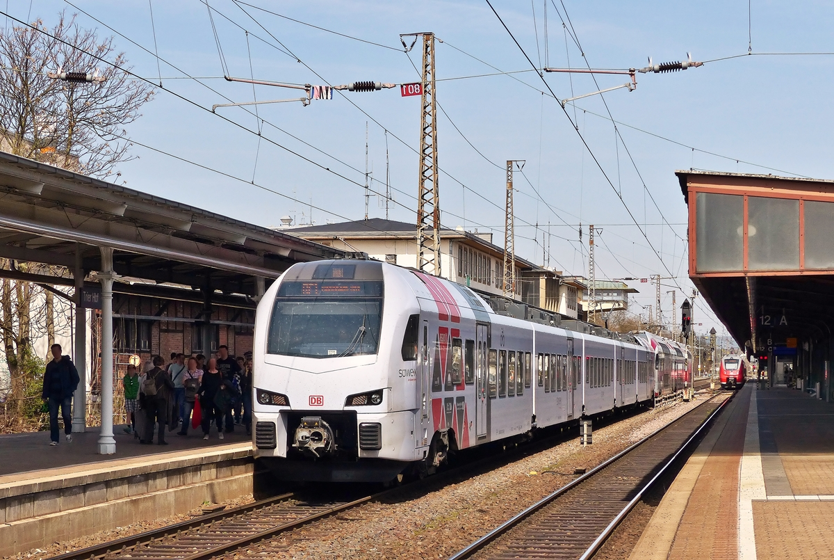 . DB Regio SÜWEX and CFL KISS are arriving together in Trier main station on April 10th, 2015.