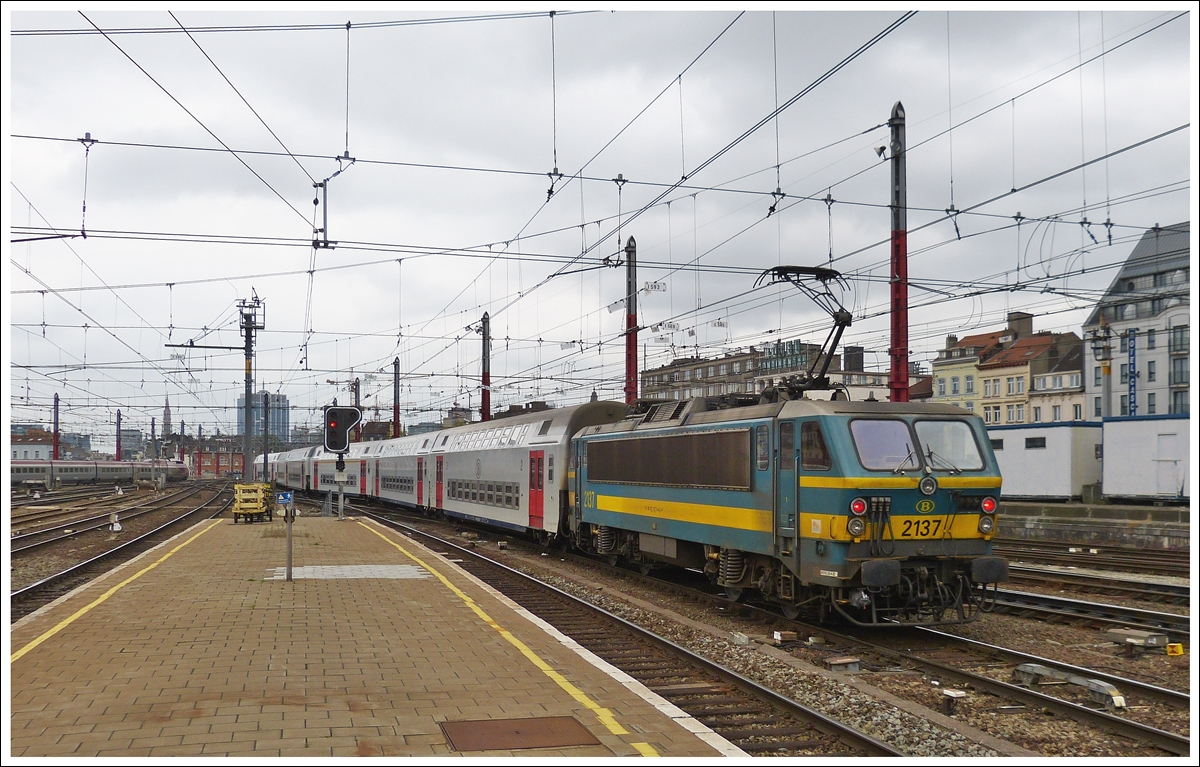 . HLE 2137 is pushing its train out of the station Bruxelles Midi on May 10th, 2013.