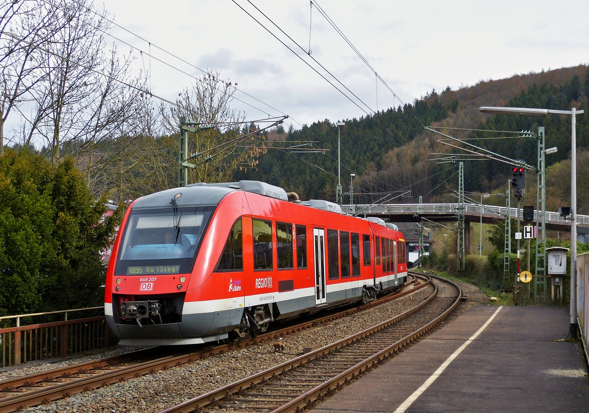 . The Alstom Coradia LINT 41 N° 648 207 of the DreiLänderBahn is entering as RB 95 Dillenburg - Siegen -  Au/Sieg into the station of Betzdorf/Sieg on March 22nd, 2014.