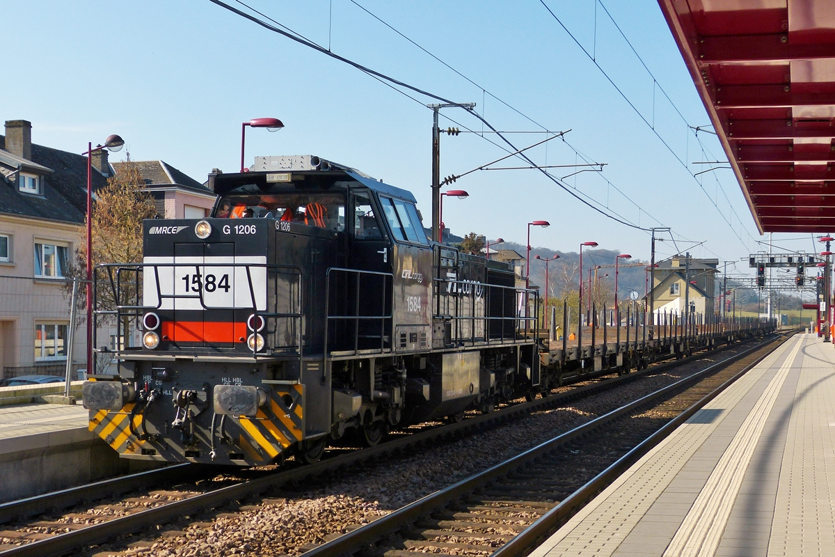 . The CFL Cargo 1584 is hauling a goods train through the station of Noertzange on March 11th, 2014.