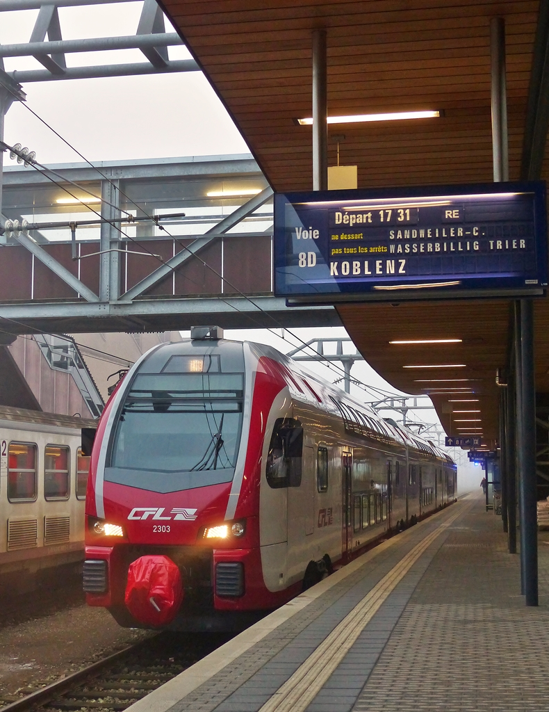 . The CFL KISS 2303 as RE 11 to Koblenz Hbf is waiting for passengers in Luxembourg City on January 5th 2015.