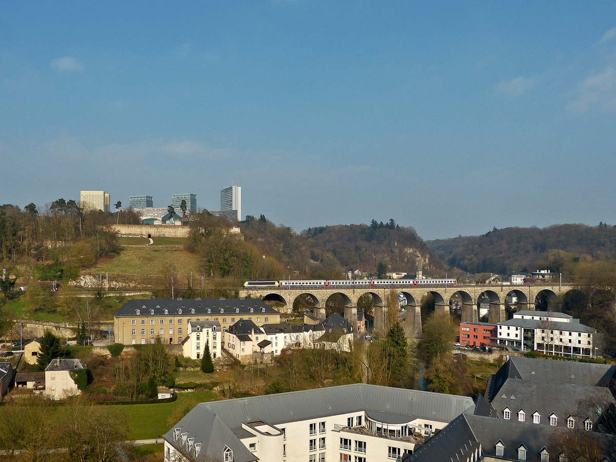. The IC 117 Luxembourg City - Liers is running on the Pfaffental viaduct in Lucembourg City on March 23rd, 2015.