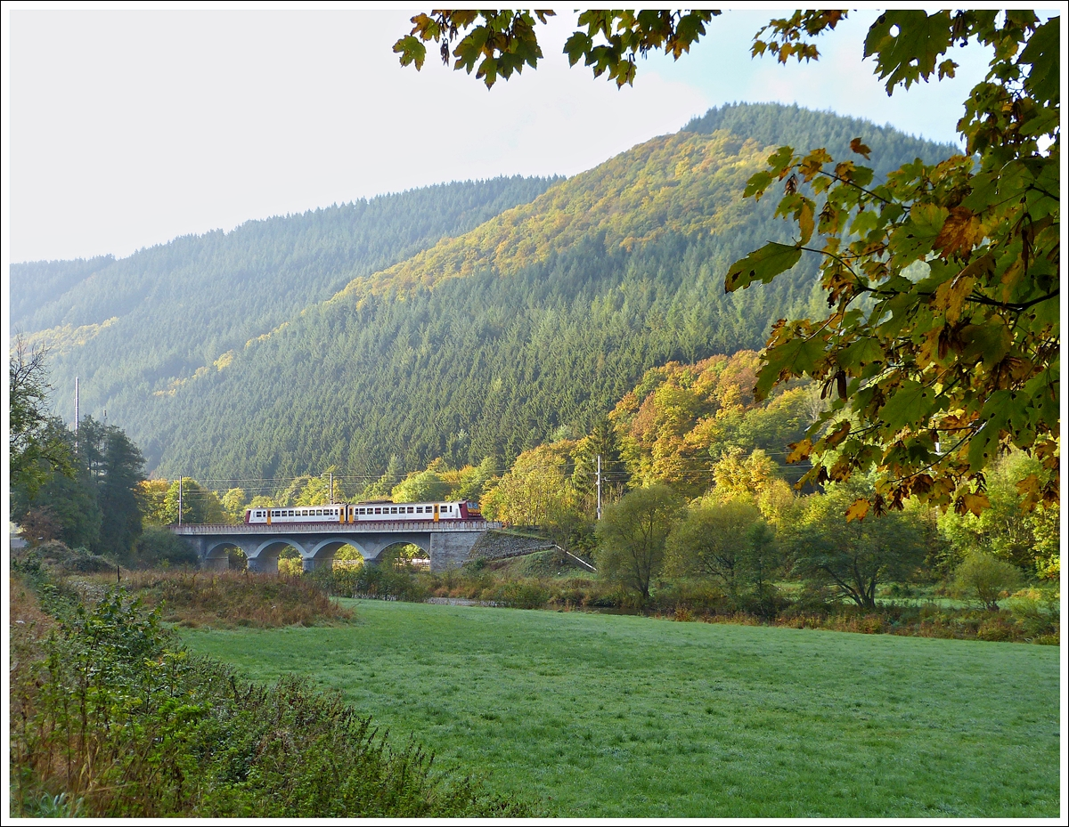 . The RB 3235 Wiltz - Luxembourg City is crossing the Sûre Bridge in Michelau on October 19th, 2013.
