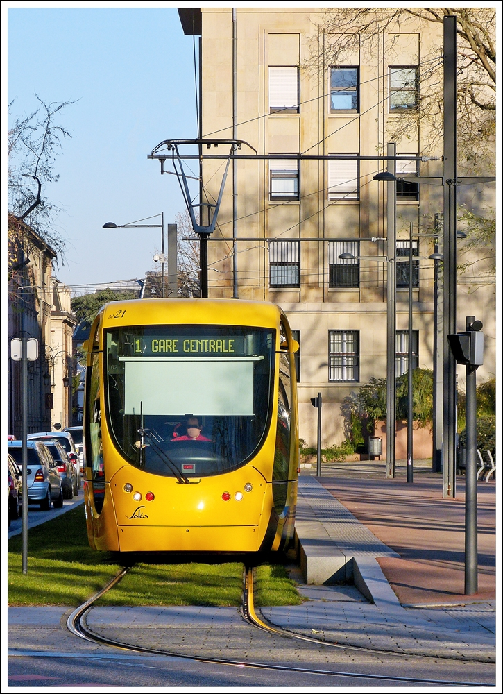 . The Soléa tram N° 2021 is running through Rue du 17 Novembre in Mulhouse on December 10th, 2013.