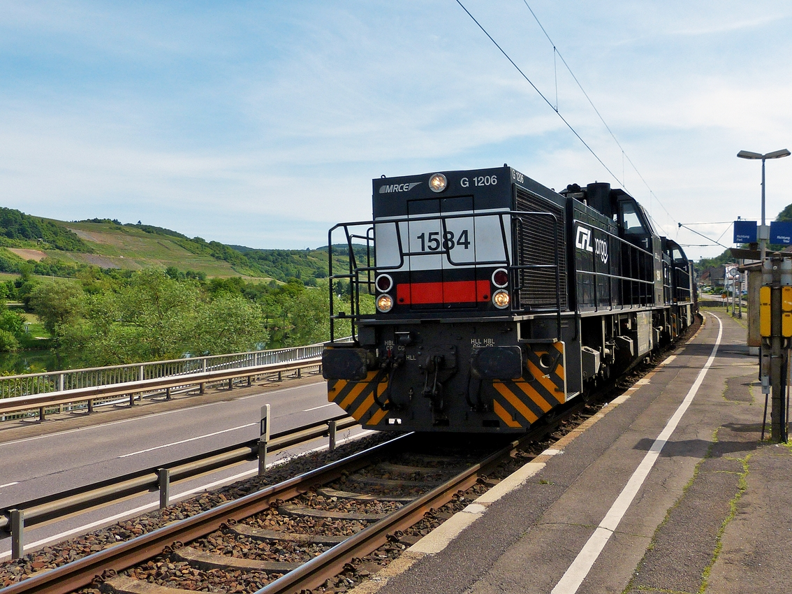 . Two CFL Cargo 1580 engines are hauling a freight train through Oberbillig on May 25th, 2014.