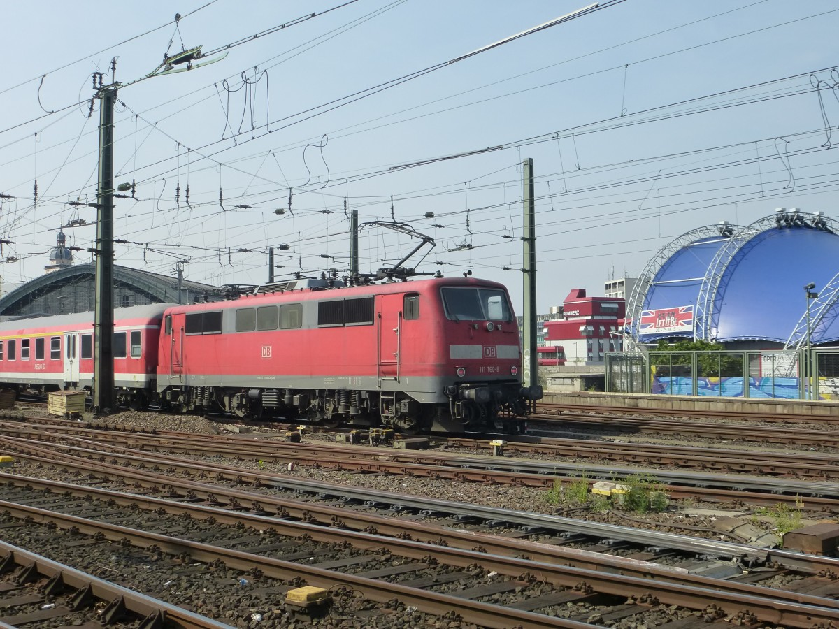 111 160 is driving between the main station and the Hohenzollernbridge in Cologne on August 22nd 2013.
