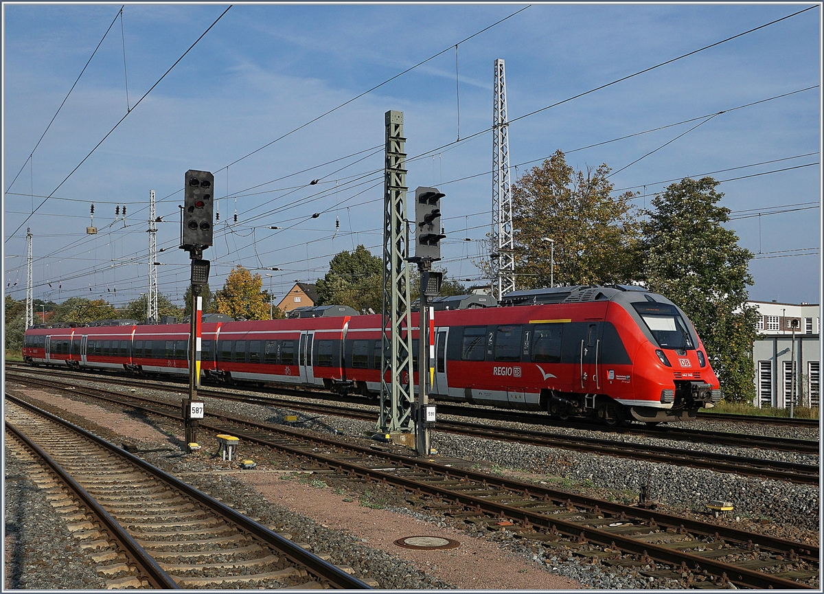 A DB 442 is arriving at Rostock Main Station.